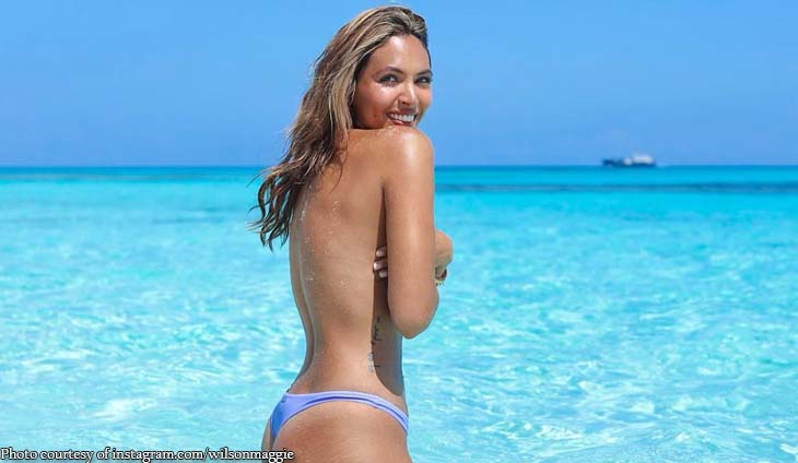 Maggie Wilson goes topless in Bahamas